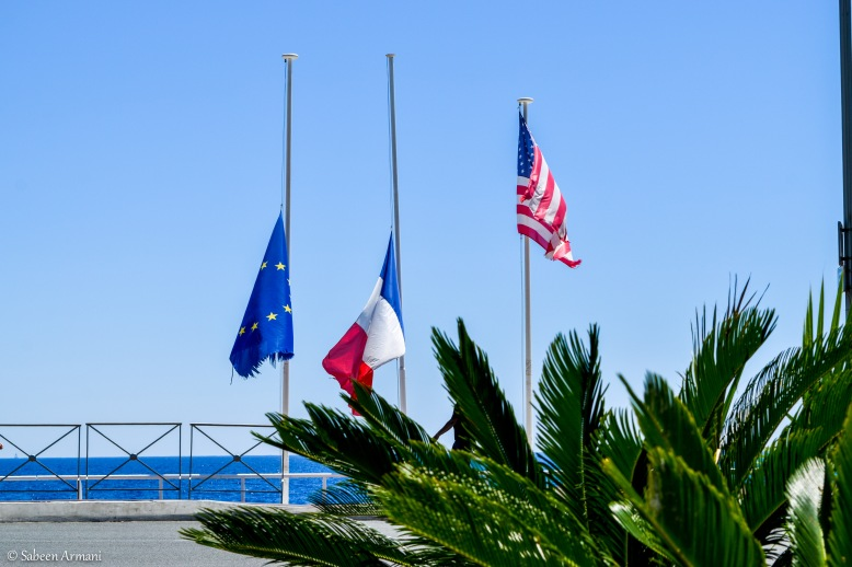 French and European flags at half-mast on the Promenade des Anglais during the three day national mourning period